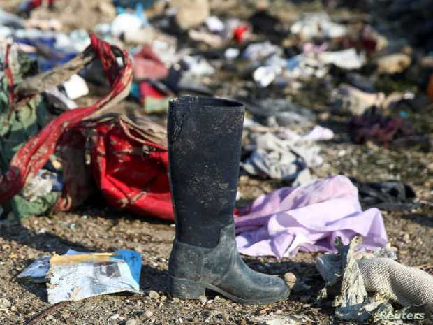Passengers' belongings are pictured at the site where the Ukraine International Airlines plane crashed after take-off from Iran's Imam Khomeini airport, on the outskirts of Tehran